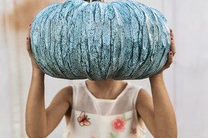 A Girl Holding Blue Pumpkin