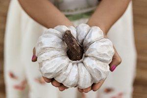 Crop Child Holding White Pumpkin
