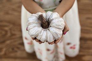 A Little Girl Holding White Pumpkin