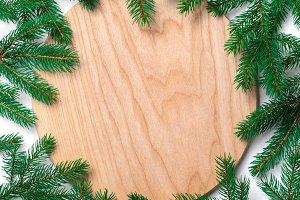 Fir Branches and Wooden Board Backgr