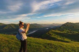 Woman taking photo in mountain