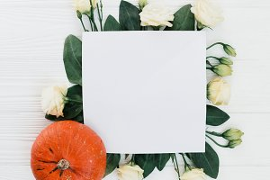 Flowers and pumpkin on table mockup