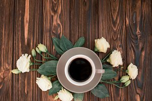 Coffee and flowers top view