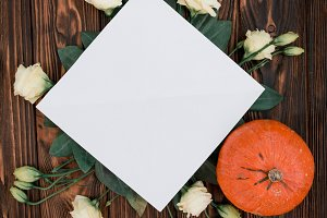 Flowers and pumpkin on wood mockup