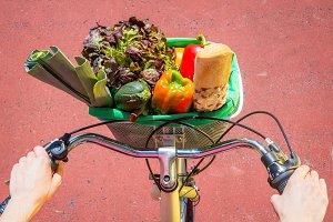Top view of groceries in basket bike
