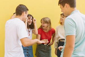 Group teenagers playing