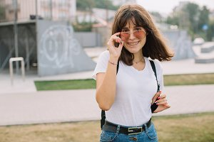 Smiling teen girl in glasses