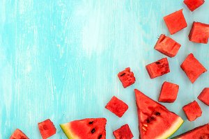 pieces of watermelon on blue wooden