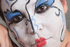 Woman with circus makeup.