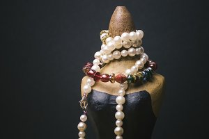 Miniature mannequin with necklaces