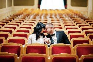 Wedding couple at hall amphitheater