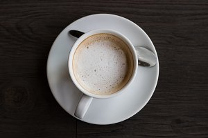Top view of coffee cup on wood floor