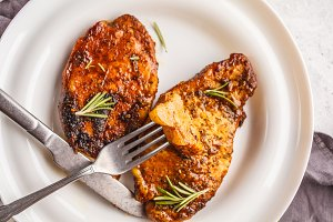 Baked steak pork with rosemary