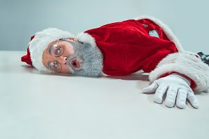 red white santa claus overworked