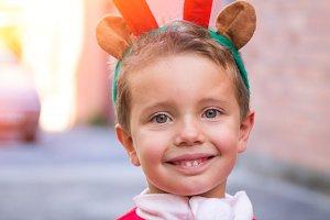 Portrait of boy with reindeer ears c