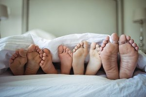 Family feet sticking out from
