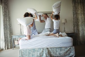 Parents and kids having pillow fight