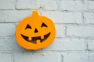 Halloween pumpkin close up on the br
