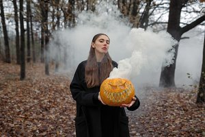 Young woman holding the halloween pu