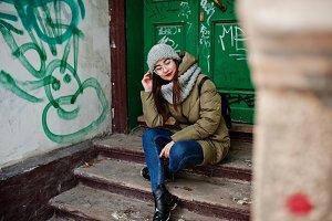 Portrait of brunette girl in gray sc