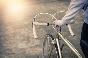 young athlete's hand with bicycle, l