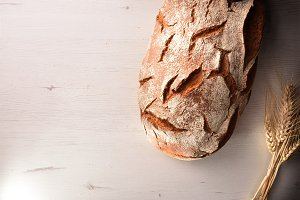 Rustic bread on a white table top