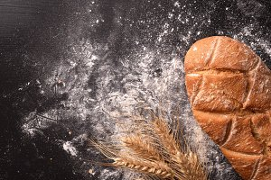 Bread on black wooden table close up