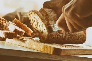 Chef slicing bread in slices vintage