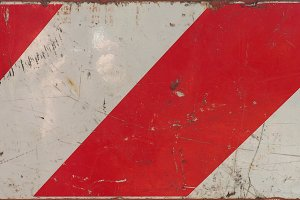 red and white striped sign
