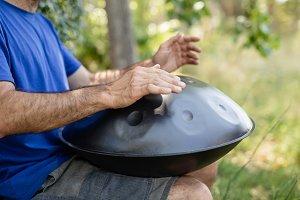 Man playing handpan
