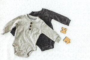 Clothes for baby on the bed