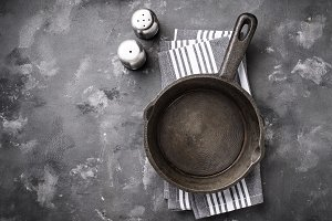 Cast iron frying pan on grey table