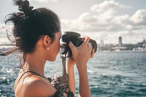 Woman photographer, taking pictures