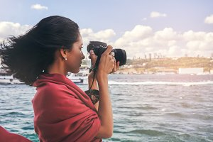 Woman photographer with red scarf