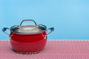 New red kitchen pot for cooking.