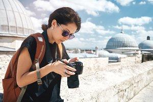 Girl traveler photographer taking