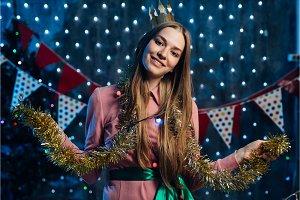 Girl playing with tinsel Christmas