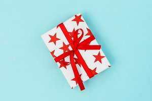 Gift box red stars blue background V