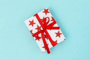 Gift box red stars blue background V