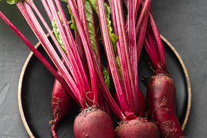 Beet, beetroot bunch on wooden plate