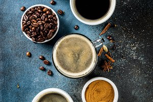 Coffee cups with beans and ground co