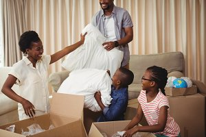 Parents and kids opening cardboard