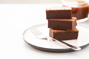 Chocolate brownie square pieces in