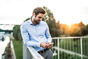 A young businessman with smartphone