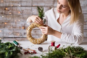 A young woman making a Christmas
