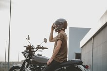biker siting on classic motorcycle by  in Transportation