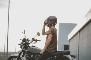 biker siting on classic motorcycle