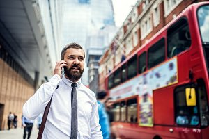 Hipster businessman on the street in