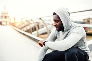 Young sporty black man runner with