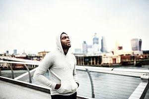 Black man runner walking on the